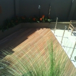 jarrah-timber-decking-around-pool-in-perth